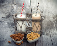 Different vegan milks on a table stock image