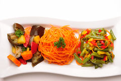Different vegetable salads on plate. Stock Photos