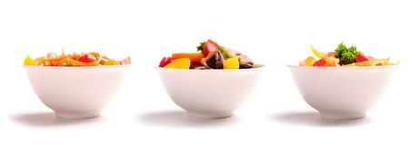 Different vegetable salads on plates. Royalty Free Stock Image