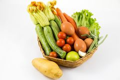 Different vegetables in the basket isolated white background royalty free stock photography