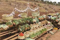 Different vegetables in baskets on a farmer market Stock Images