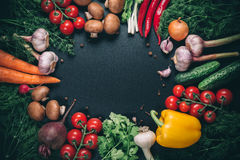 Different vegetables. Beautiful background healthy organic eating. Studio photography the frame of different vegetables and mushrooms on vintage table with free Stock Photo