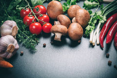 Different vegetables. Beautiful background healthy organic eating. Studio photography the frame of different vegetables and mushrooms on vintage table with free Stock Images