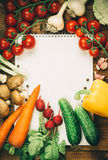 Different vegetables. Beautiful background healthy organic eating. Studio photography the frame of different vegetables and mushrooms with a white sheet of paper Royalty Free Stock Images