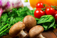 Different vegetables. Beautiful background healthy organic eating. Studio photography of different vegetables and mushrooms on the old brown boards Royalty Free Stock Photography