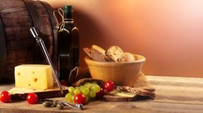 Different vegetables,with cheese,olive oil,rye bread and barrel Royalty Free Stock Photos