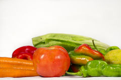 Different vegetables and fruits with blank space at top. Different vegetables and fruis such as tomatoes, carrots, red and green peppers, lettuces and  lemons Royalty Free Stock Photo