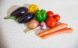 Different vegetables lying on the table. In the kitchen Royalty Free Stock Photo