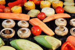 Different Vegetables Mix On The Hot BBQ Grill Background Royalty Free Stock Photos