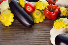Different vegetables on a wooden striped background Royalty Free Stock Photo