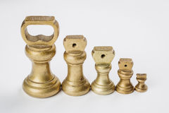 Different vintage brass weights unit standing Royalty Free Stock Image