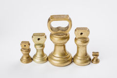Different vintage brass weights unit standing Royalty Free Stock Photo