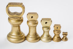 Different vintage brass weights unit standing Stock Images