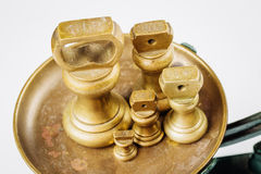 Different vintage brass weights unit standing Royalty Free Stock Photos