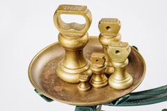 Different vintage brass weights unit standing Royalty Free Stock Images