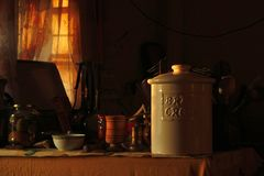 Vintage kitchen jars and bowls with beautiful back light. royalty free stock photos