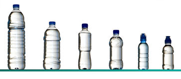 Different water bottles. Six different plastic water bottles stock photos