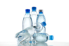Different water bottles isolated on white. Close up Stock Photos