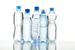 Different water bottles isolated on white. Close up Stock Photo