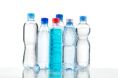 Different water bottles isolated on white. Close up Stock Images
