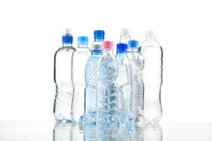 Different water bottles isolated on white. Close up Royalty Free Stock Photo