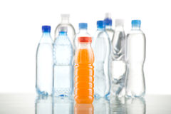 Different water bottles isolated on white. Close up Stock Image