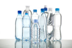 Different water bottles isolated on white. Close up Royalty Free Stock Image
