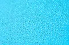 Different water drops on blue background, close up stock images