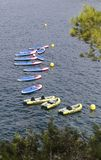 Different watercrafts to practice summer activities. Different watercrafts used to practice summer activities like stand up paddle or canoeing seen prepared in stock photography
