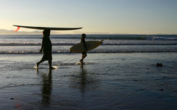 Different ways of carrying a surfboard Stock Images