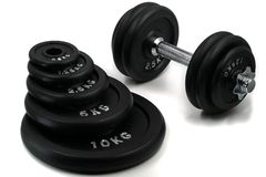 Different weights for bodybuilding with dumbbell isolated on white background stock photography