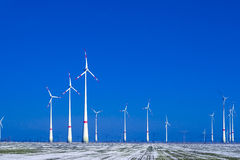 Different windmills in winter landscape Stock Photography