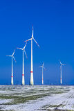 Different windmills in winter landscape Stock Images