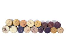 Different wine corks. In a row, isolated on white Royalty Free Stock Images