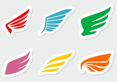 Different wings stickers color. On gray Royalty Free Stock Image