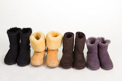 Different winter boots on a white background. Royalty Free Stock Photography