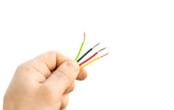 Different wires in his hand. On a white background Royalty Free Stock Photo