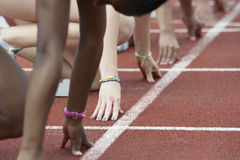 Different woman's hands in the starting block Stock Images