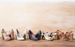 Different woman`s shoes on wooden floor Stock Photography