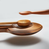 Different wood spoon in air. On a white background royalty free stock photography