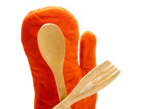 Different Wooden Cooking Spoon with Red Potholder Glove Stock Photo
