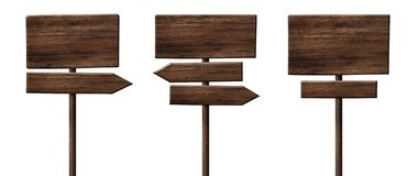 Different wooden direction arrow signposts or roadsigns made of dark wood. Different empty direction arrow signpost or roadsign made of dark wood with single stock photography
