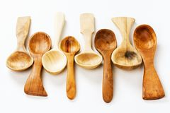 Different wooden spoons. Are on white background, wood carving and woodcraft concept royalty free stock images