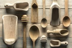 Different wooden utensils on wooden table Royalty Free Stock Image