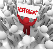 Different Word Sign Unique Man Standing Out in Crowd of People Stock Images