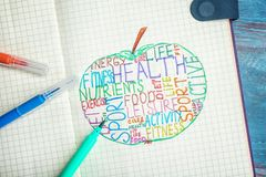 Different words written in notebook on wooden table. Health care concept