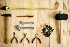 Different working and repair tools. On a wooden background stock photo