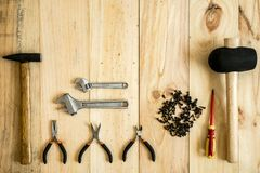 Different working and repair tools. On a wooden background with space for text royalty free stock image