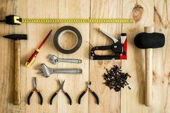 Different working and repair tools. On a wooden background stock image