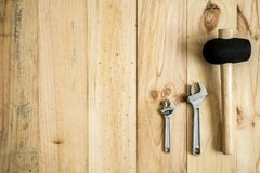 Different working and repair tools. On a wooden background with space for text stock photos